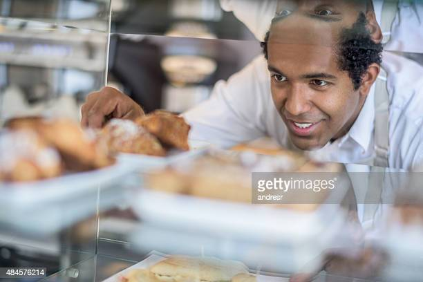 Man working at a pastry shop