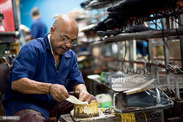 Man working at a shoe making factory