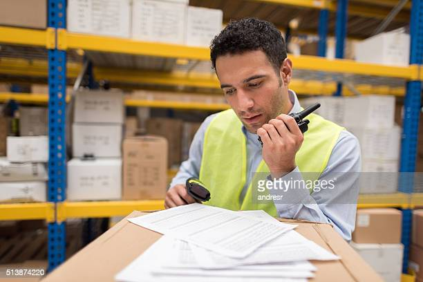 Man working at a warehouse doing inventory