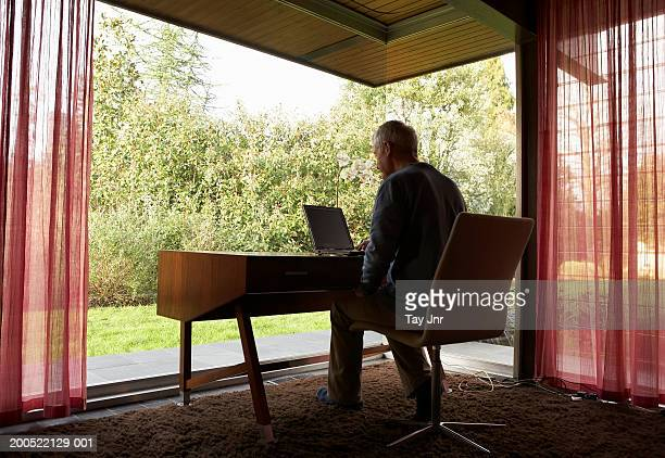 Man working at desk in front of window
