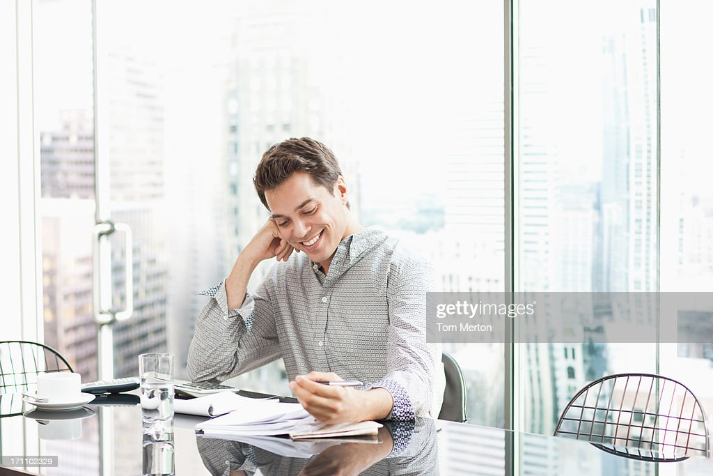 Man working at desk : Stock Photo