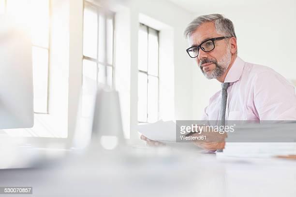 Man working at desk, portrait