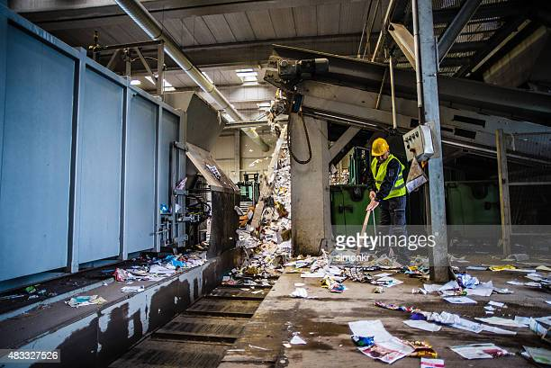 Man working at garbage recycling plant