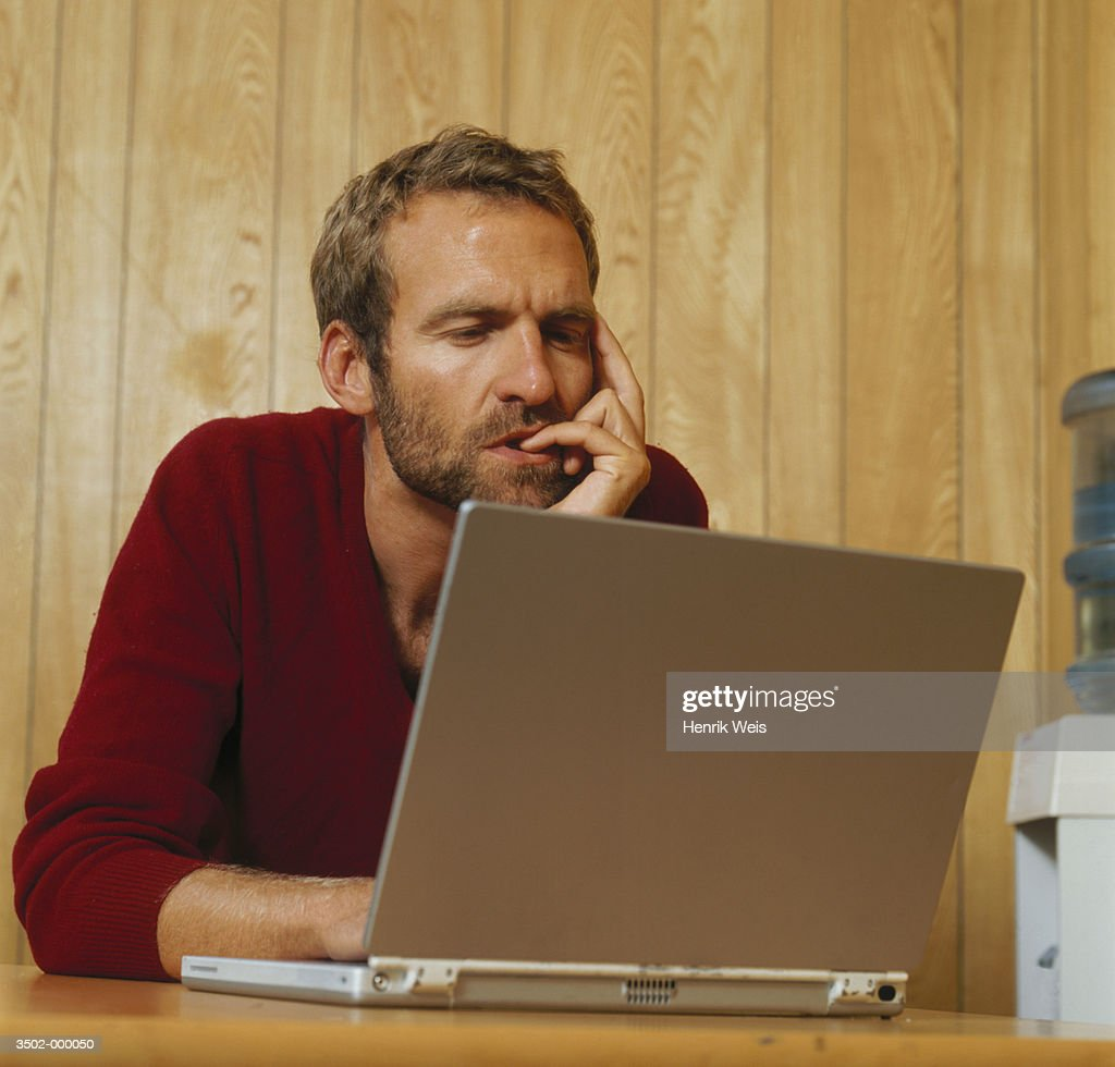 Man Working at Home : Stock Photo