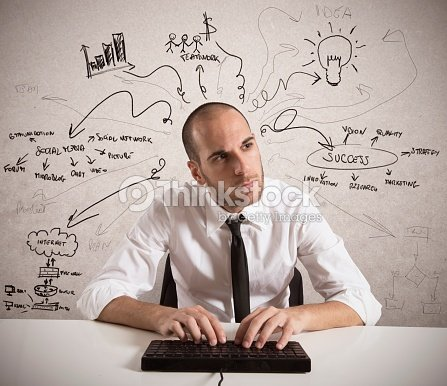 Man working at keyboard with pointing slogans on white board : Stock Photo