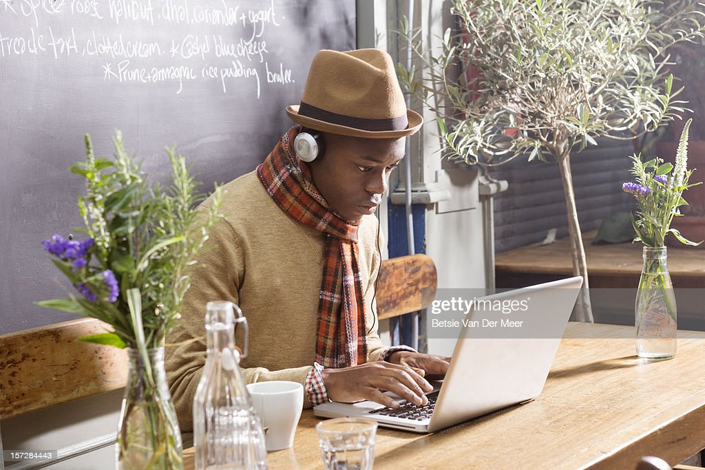 Man working at laptop in pavement cafe. : Stock Photo