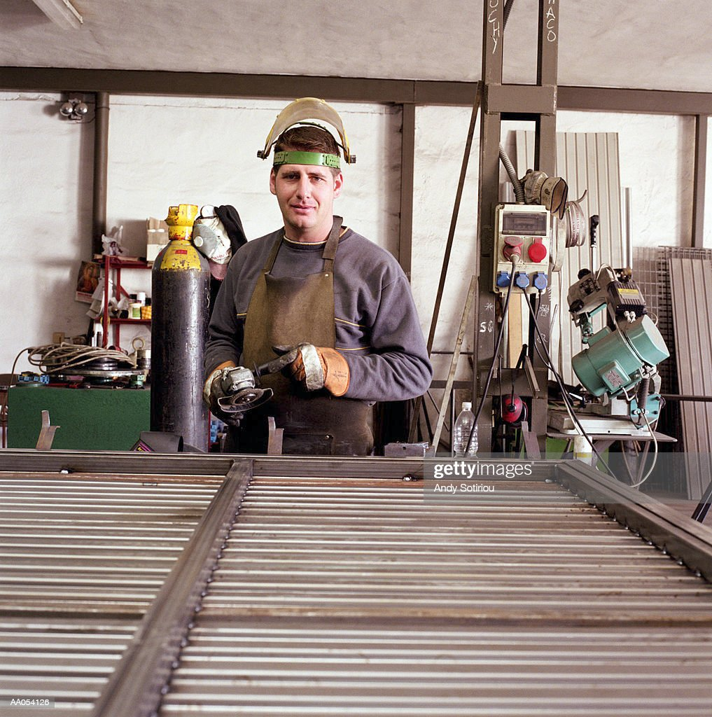 Man working at metal shop, portrait