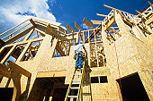 Man working at new home construction, low angle view
