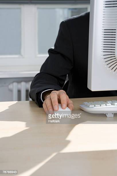 A man working behind a computer