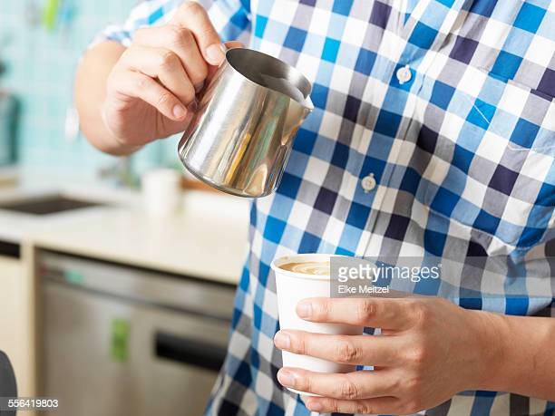 Man working behind coffee bar