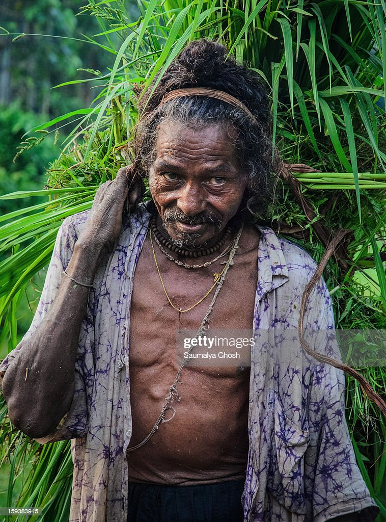 CONTENT] A man working in a forest of Dooars region in the foothills of Himalayas.