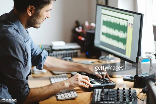 Man working in a home apartment workstudio