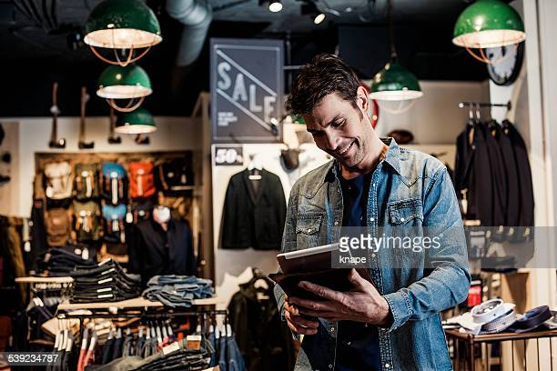 Man working in a small business retailer at fashion store