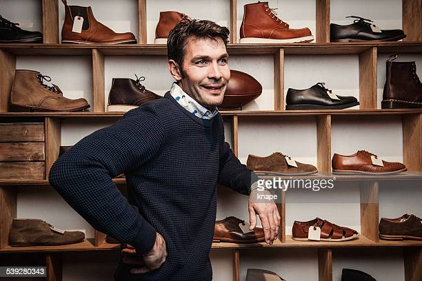 Man working in a small business retailer at shoe store