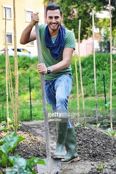 Man working in a Urban City Vegetables Garden