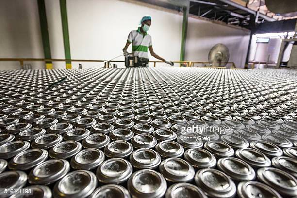 Man working in aluminium can processing plant