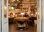 man working in antique shop