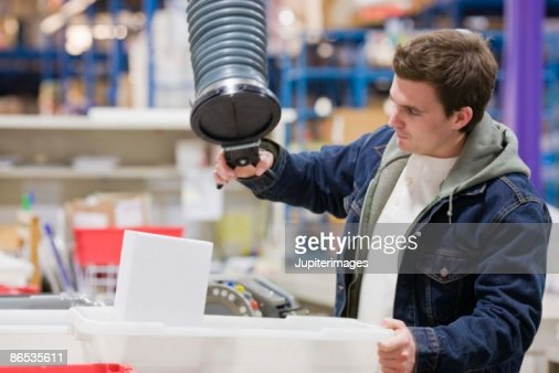 Man working in factory : Photo