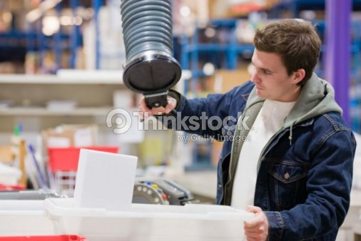Man working in factory : Stock Photo