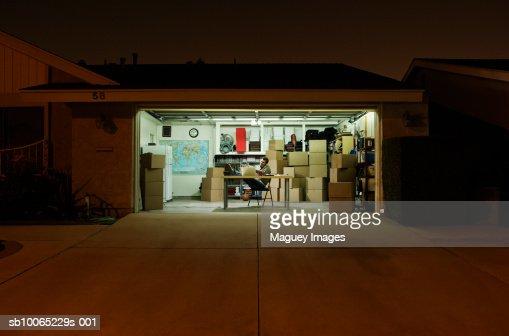 Man working in garage at night