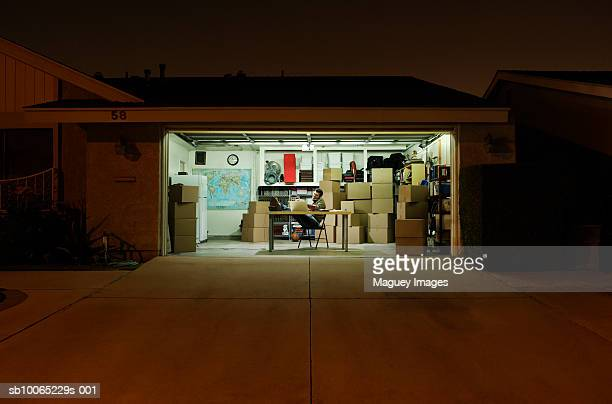 Man working in garage at night