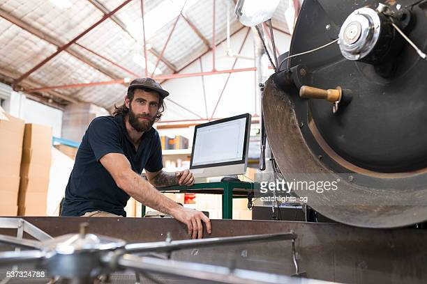 Man Working in Gourmet Coffee Roasting Factory
