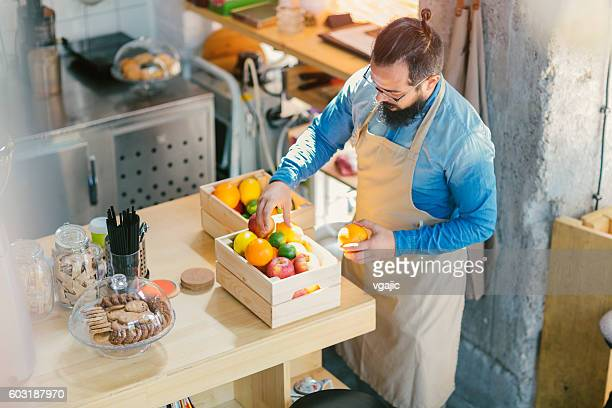 Man Working In His Cafe