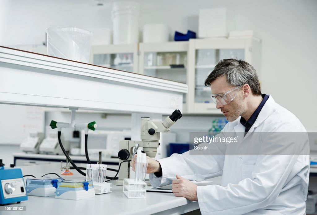 Man working in laboratory : Stock Photo