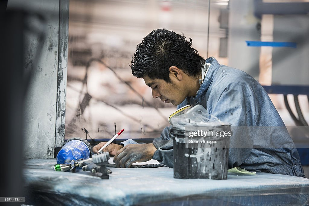 Man working in manufacturing plant : Stock Photo