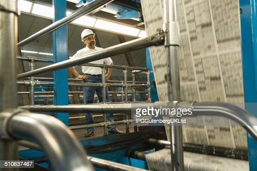 Man working in newspaper factory : Stock Photo