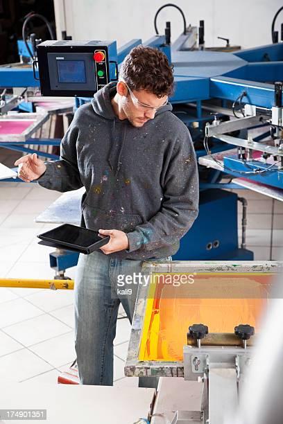 Man working in screen printing shop