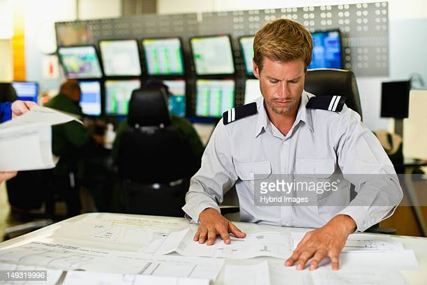 Man working in security control room