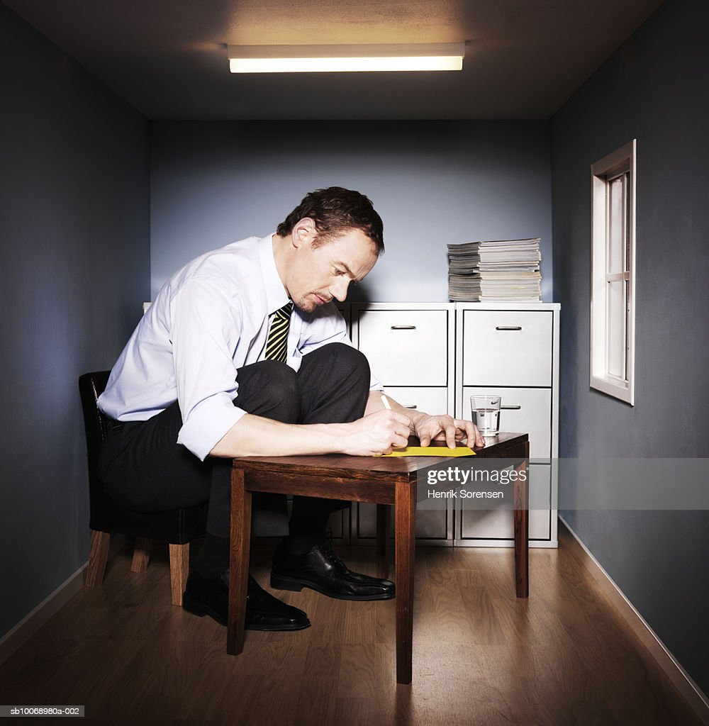 Man working in small office : Stock Photo