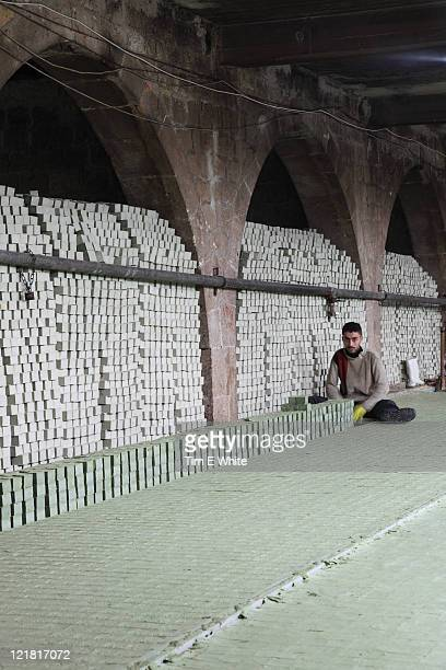 Man working in soap factory, Aleppo, Syria