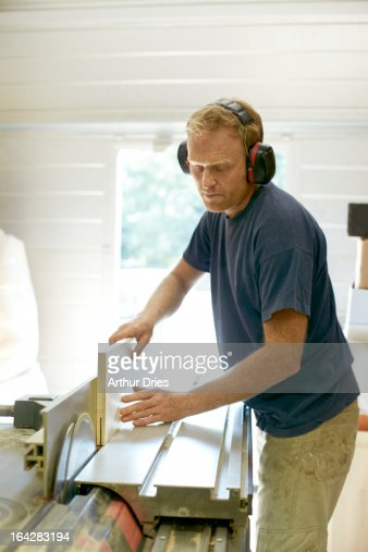 Man working in woodshop : Stock Photo