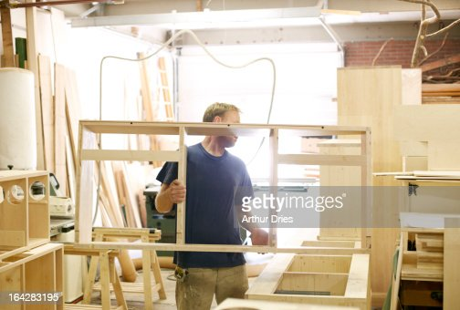 Man working in woodshop : Stock Photo