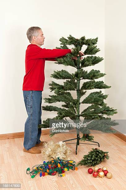 Man Working on a Christmas Tree
