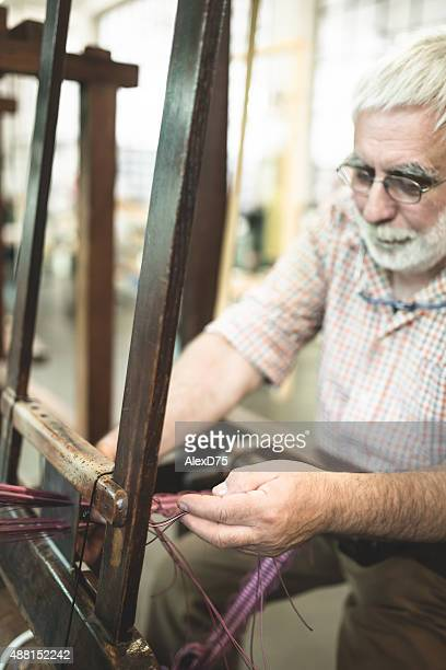 Man working on a loom