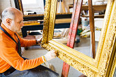 Man Working on Antique Gold Picture Frame