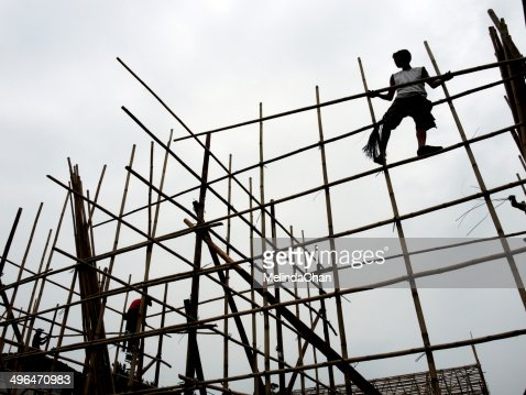 Man working on bamboo construction