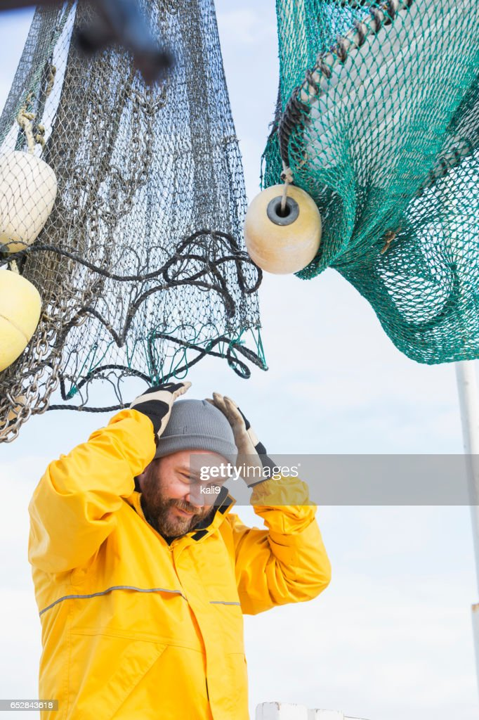 Man working on commercial shrimp boat : Stock Photo
