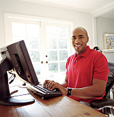 Man working on computer in home office