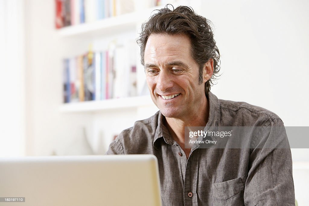 Man working on computer : Stock Photo