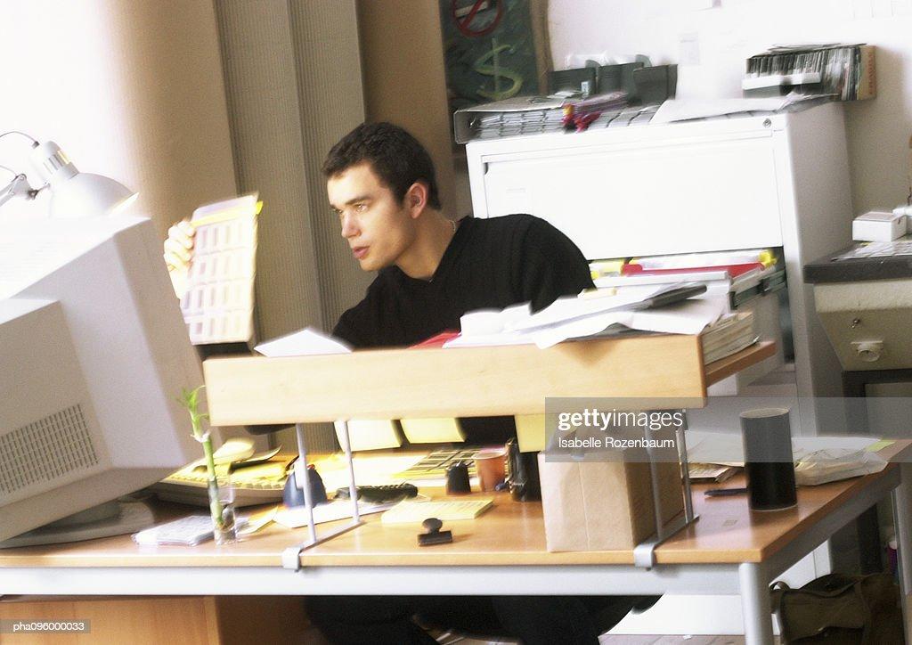Man working on computer : Stock Photo