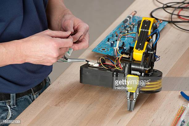 Man working on Electronic Robotics