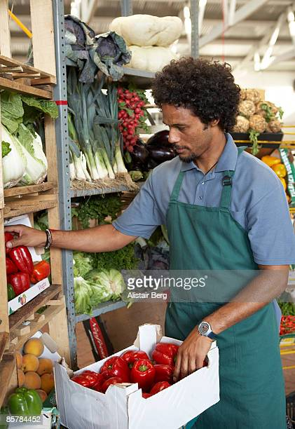 Man working on fuit and vegetable stall