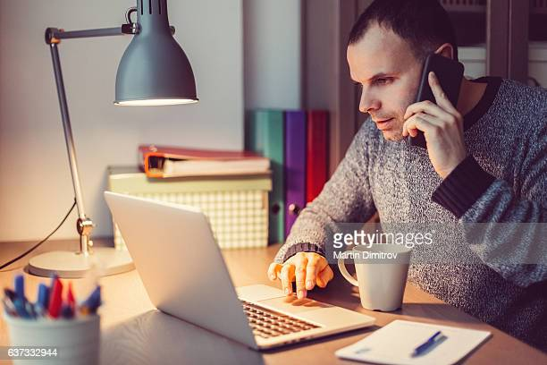 Man working on lap top late at night