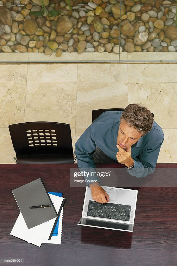 Man working on laptop computer : Stock Photo