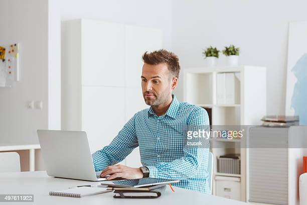 Man working on laptop in a home office