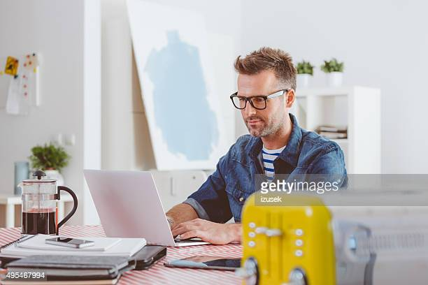 Man working on laptop in an home office